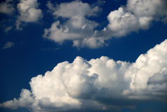 Hard clouds against blue sky Stock Photography