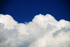 Hard clouds against blue sky Stock Photo