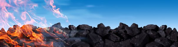 A pile of black coal burns and releases carbon dioxide into the atmosphere between other poisons. Hard coal is one of the greatest treasures of humanity. It is royalty free stock images