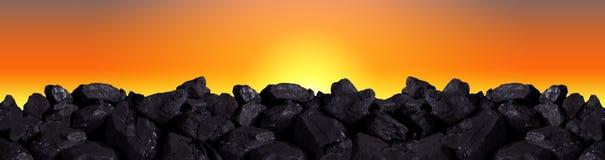 Black coal in the glow of the setting sun. stock photos