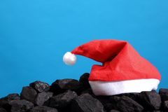 Hristmas symbols on a black coal heap. stock images
