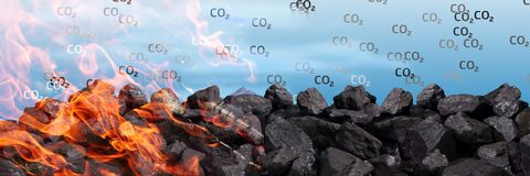 A pile of black coal burns and releases carbon dioxide into the atmosphere between other poisons. royalty free stock photography