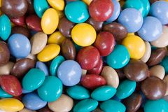 Hard Coated Chocolate Candies. Wall to wall candy covered chocolate treats. They melt in your mouth, not in your hand. Excellent colorful background image royalty free stock images