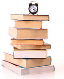 Hard cover books and alarm clock isolated Stock Photo