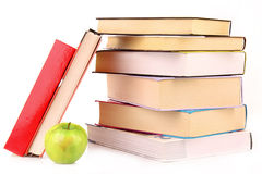 Hard cover books and green apple Royalty Free Stock Photography