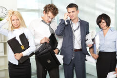 Hard day. Group of tired and annoyed businesspeople after hard working day Royalty Free Stock Photography