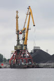 Hard day for the harbour crane Stock Image
