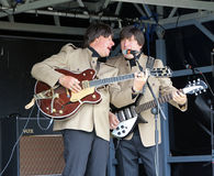 Hard days night electric beatles. Photo of the electric beatles tribute band singing hard days night on stage at the whitstable kent summer festival 2014 royalty free stock photos