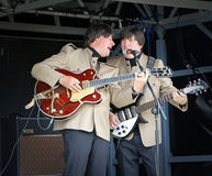 A hard days night. Photo of the electric beatles tribute band in action performing at the annual whitstable classic car show during 2013. photo ideal for workers royalty free stock images
