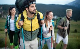 Hard, difficult, tiring and exhausting expedition of four friends in wild. Hard, difficult, tiring and exhausting expedition of four friends stock photography