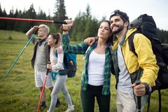Hard, difficult, tiring and exhausting expedition of four friendson mauntain. Hard, difficult, tiring and exhausting expedition of four friends on the mountain royalty free stock image