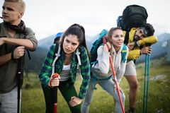 Hard, difficult, tiring and exhausting expedition of four friendson mauntain. Hard, difficult, tiring and exhausting expedition of four friends on the mountain royalty free stock images