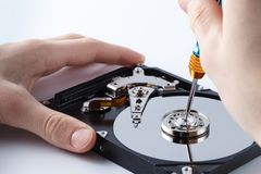 Hard disc drive disassembling close up. Repairman opening hdd fo. R recovery information, service center and electronics repair concept Stock Image