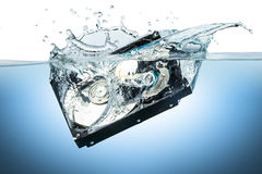 Hard disc drive water splash. Hard disc drive splashes into water Stock Photo