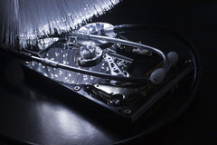 Hard disc and stethoscope Royalty Free Stock Photography