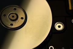 Hard disk. A finger's digial on digital hard disk royalty free stock images