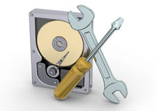 Hard Disk and Assistive Tool Royalty Free Stock Photos