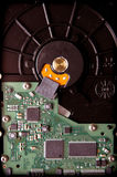 Hard disk base with green microcircuit components Royalty Free Stock Image