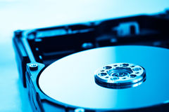 Hard disk in blue light Royalty Free Stock Photos