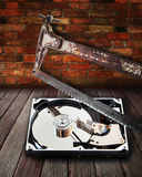 Hard disk cut with a hacksaw Royalty Free Stock Image