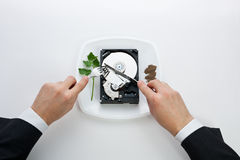 Hard Disk Cut With A Knife Man Royalty Free Stock Photos