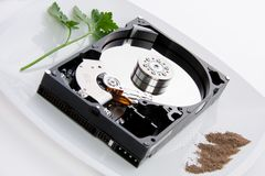 Hard disk on a dish Royalty Free Stock Images