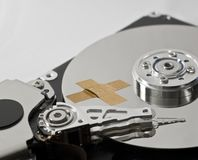 Hard disk drive with band-aid Stock Images