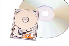 Hard disk drive and compact dics isolated on white Royalty Free Stock Photos