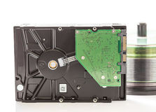 Hard disk drive and compact discs Royalty Free Stock Image