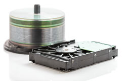Hard disk drive and compact discs Royalty Free Stock Photos