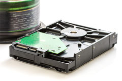 Hard disk drive and compact discs Royalty Free Stock Images