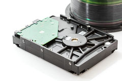Hard disk drive and compact discs Royalty Free Stock Photo