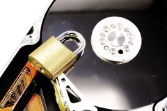 Hard disk with a closed padlock as a concept for computer data s stock images