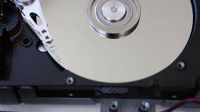 Hard Disk Drive, computer data storage, mirror surface. Close-up stock footage