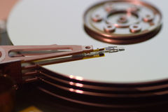 Hard disk drive (hdd). Hard disk drive - head and surfaces Royalty Free Stock Images
