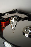 Hard disk with drive head Royalty Free Stock Photography