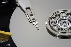 Hard disk drive and head. Macro view of hard disk drive platter and head with copy space Royalty Free Stock Images