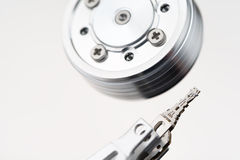 Hard disk drive head background Stock Photography