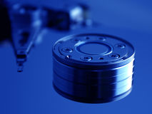 Hard Disk Drive II. Close-up of the opened Hard Disk Drive, extreme blue royalty free stock images