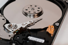 Hard disk drive inside. Magnetic head, magnetic surface of the disk stock photo