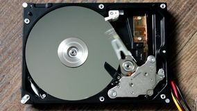 A Hard Disk Drive is open, broken and spin out stock video footage