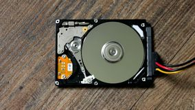 A Hard Disk Drive is open, broken and spin out stock footage