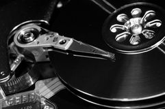 Hard disk drive. Opened hard disk drive - black and white Stock Images