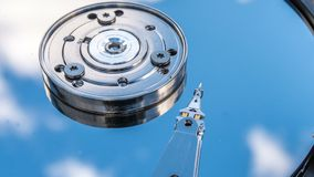 Hard disk drive with reflected in it the time-lapse of clouds, the concept of cloud storage.  stock video footage