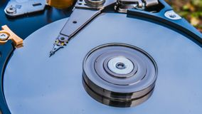 Hard disk drive with reflected in it the time-lapse of clouds, the concept of cloud storage.  stock footage
