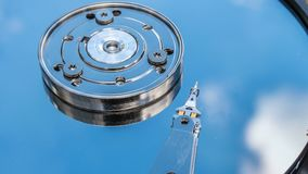Hard disk drive with reflected in it the time-lapse of clouds, the concept of cloud storage, video loop.  stock video