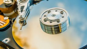 Hard disk drive with reflected in it the time-lapse of clouds, the concept of cloud storage, video loop.  stock footage