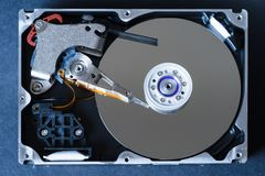 Hard disk drive with removed cover, hdd inside flat view, spindle, actuator arm, read write head, platter, ribbon cable.  Stock Photos
