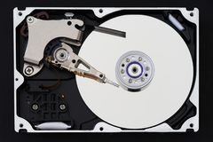 Hard disk drive with removed cover, hdd inside flat view, spindle, actuator arm, read write head, platter, ribbon cable.  stock image