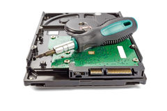 Hard disk drive with screwdriver on a white background Stock Photos